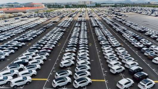 Kia Motors Corp. vehicles sit parked in this aerial photograph taken above the company's delivery center in Gwangju, South Korea, on Friday, July 8, 2016.