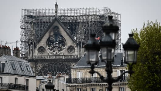 Scaffolding which was erected for the renovation of the landmark Notre-Dame Cathedral, remains in place a day after a devastating fire destroyed the roof and other areas of the Gothic cathedral in central Paris on April 16, 2019.