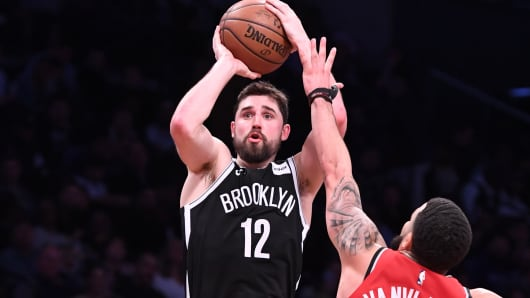 Joe Harris No. 12 of the Brooklyn Nets shoots against Fred VanVleet No. 23 of the Toronto Raptors at Barclays Center on April 3, 2019 in Brooklyn, New York.