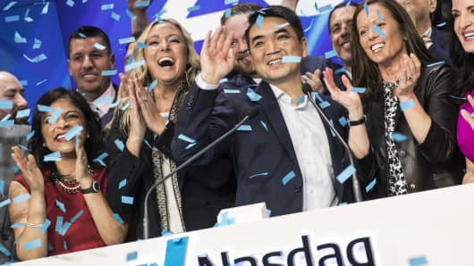 Eric Yuan, founder and chief executive officer of Zoom Video Communications Inc., center, rings the opening bell during the company's initial public offering (IPO) at the Nasdaq MarketSite in New York, U.S., on Thursday, April 18, 2019.