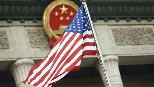 The U.S. flag flies at a welcoming ceremony between Chinese President Xi Jinping and U.S. President Donald Trump in 2017.