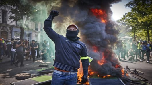French protesters set fires in Paris as unrest grows after Notre Dame blaze