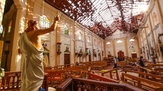 Officials inspect the damaged St. Sebastian's Church after several explosions against churches and hotels in Sri Lanka on April 21, 2019 in Negombo, north of Colombo, Sri Lanka.