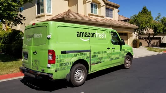 Amazon to spend $800 million this quarter to make free one-day shipping the default for Prime members