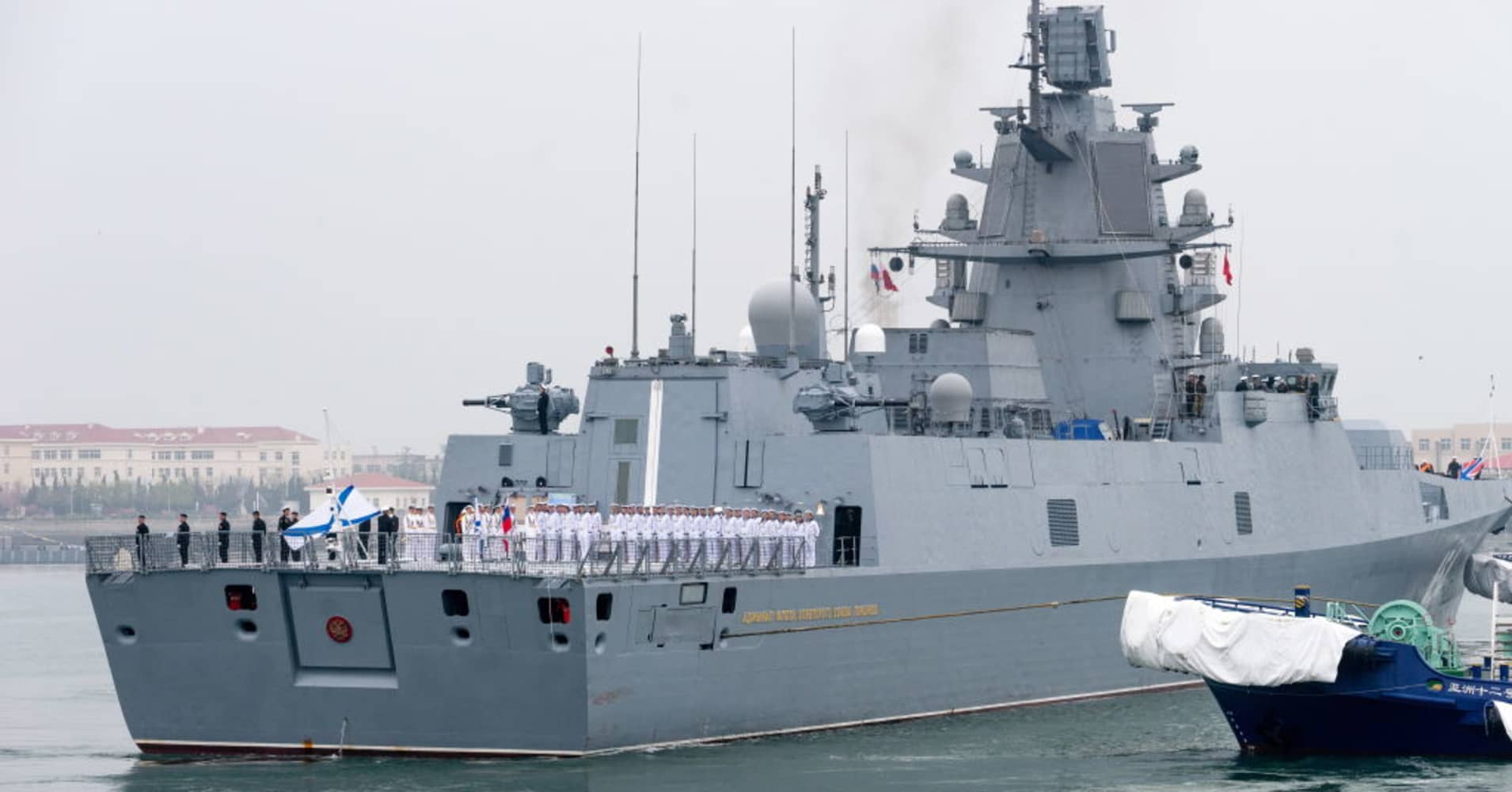 'Chinese people love and long for peace,' President Xi says as major naval parade kicks off