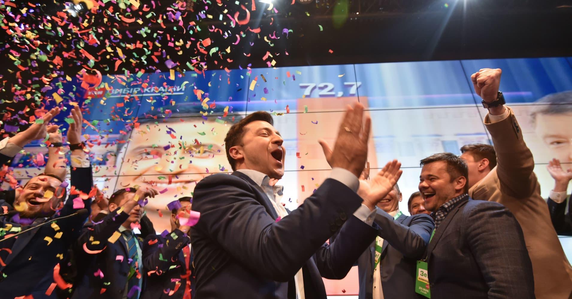 Ukraine faces up to reality after political novice wins landslide