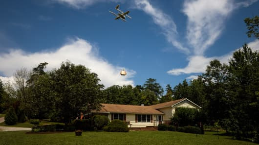 A Wing drone delivers a package to a home during a demonstration in Blacksburg, Virginia, U.S., on Tuesday, Aug. 7, 2018.