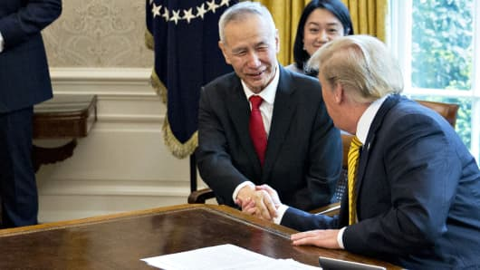 Liu He, China's vice premier, left, shakes hands with U.S. President Donald Trump during a meeting in the Oval Office of the White House in Washington, D.C., April 4, 2019.