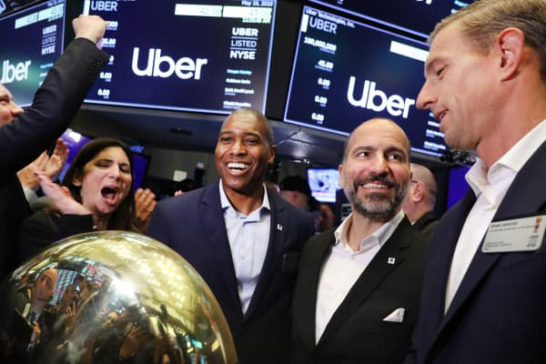 Uber co-founder Ryan Graves (right) stands with CEO Dara Khosrowshahi on the floor before ringing a ceremonial bell signifying the first trade as the ride-hailing company Uber makes its highly anticipated initial public offering on May 10, 2019 in New York City.