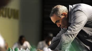 Former world chess champion Garry Kasparov plays a game of chess with school children in South Africa.