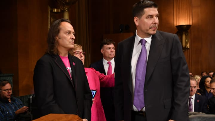 T-Mobile CEO John Legere (L) and Sprint Executive Chairman Marcelo Claure (R) arrive to testify at the Senate Judiciary Committee's Subcommittee on Antitrust, Competition Policy and Consumer Rights hearing on the proposed merger of T-Mobile and Sprint in the Dirksen Senate Office Building on Capitol Hill in Washington, DC, on June 27, 2018.