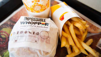 In this photo illustration, an 'Impossible Whopper' sits on a table at a Burger King restaurant on April 1, 2019 in Richmond Heights, Missouri. Burger King announced on Monday that it is testing out Impossible Whoppers, made with plant-based patties from Impossible Foods, in 59 locations in and around St. Louis area.