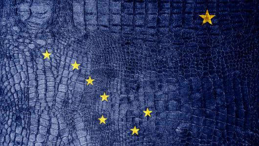 Alaska State Flag painted on luxury crocodile texture