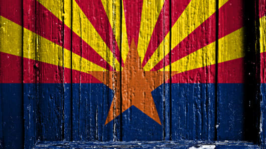 flag of Arizona painted on wooden frame