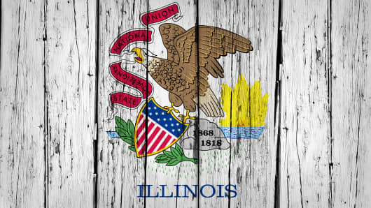 Illinois grunge wood background with Illinoisan State flag painted on aged wooden wall.