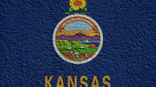 US State Politics Or Business Concept: Kansas Flag Wall With Plaster, Texture
