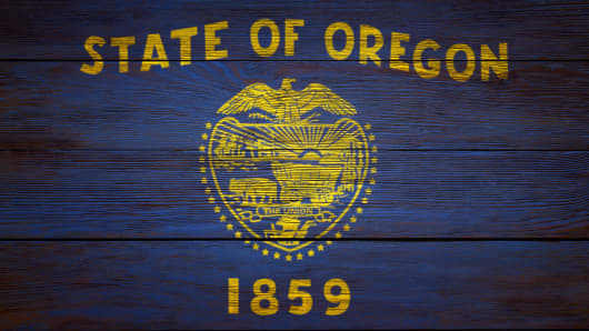Flag of Oregon stenciled on wood