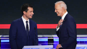 Pete Buttigieg (L) and Joe Biden exchange words during a break in the second Democratic debate hosted by NBC News in Miami, June 27, 2019.