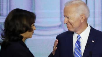 Sen. Kamala Harris (D-CA) touches former Vice President Joe Biden during the second night of the first Democratic presidential debate on June 27, 2019 in Miami, Florida.