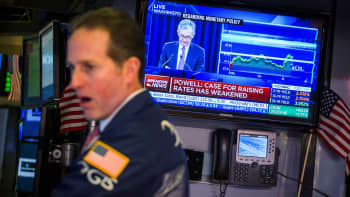 A trader works in front of a television broadcasting Jerome Powell, chairman of the U.S. Federal Reserve, on the floor of the New York Stock Exchange.