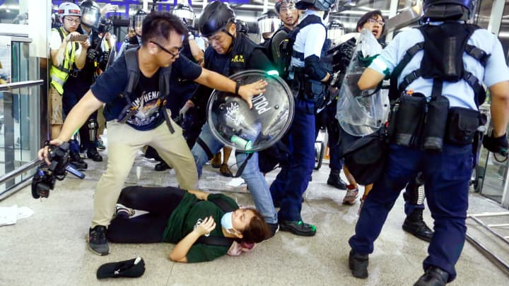 Riot police confront protesters at Hong Kong's airport