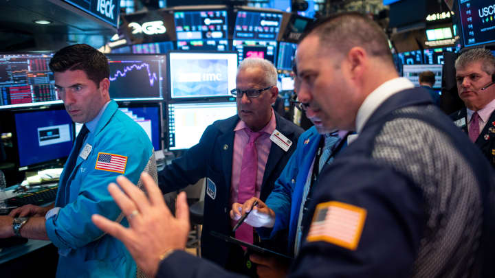 Traders work after the closing bell at the New York Stock Exchange (NYSE) on August 12, 2019 at Wall Street in New York City.