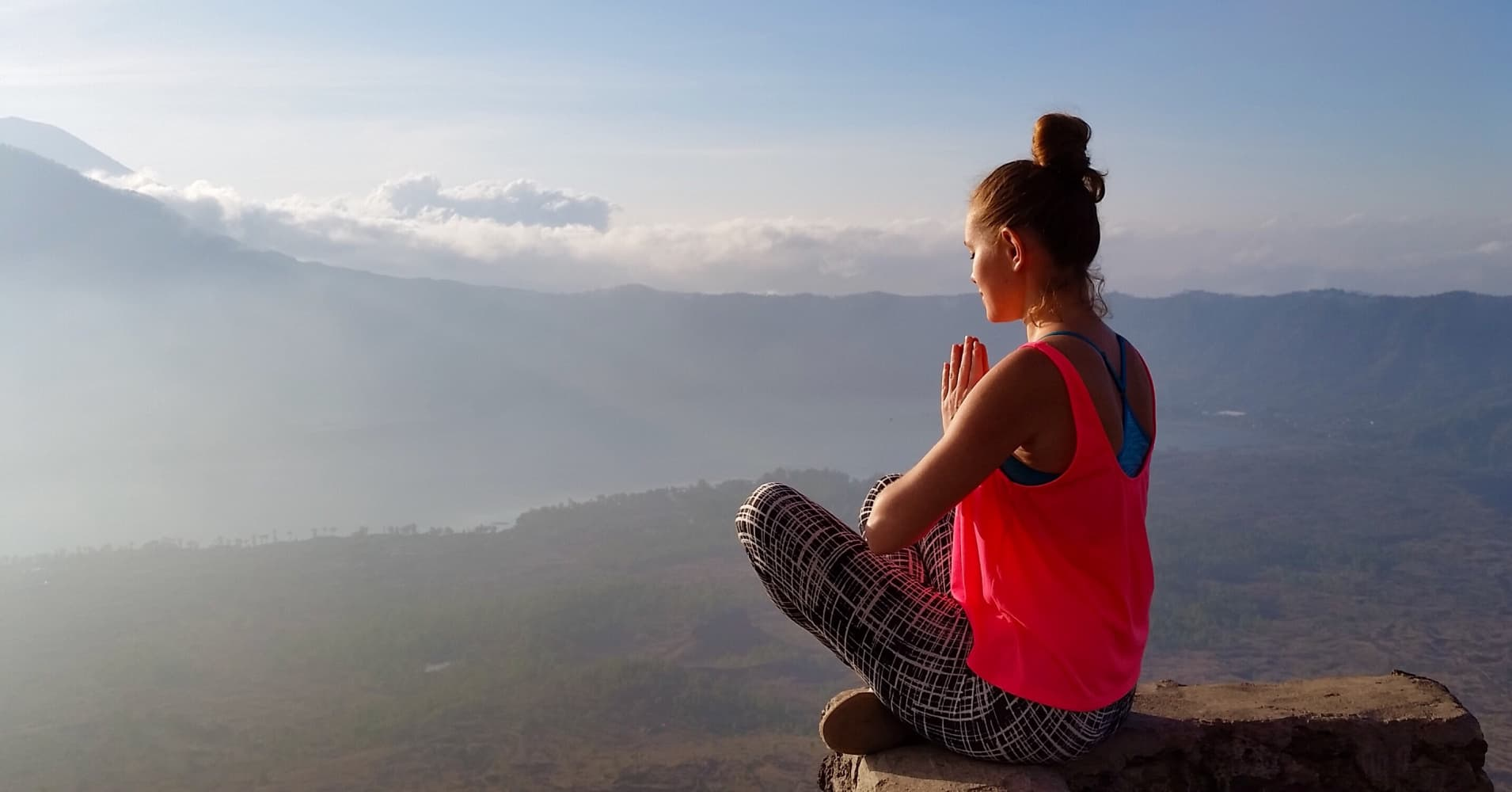 Meditation at the sunrise at the top of mount Batur in Bali, Indonesia