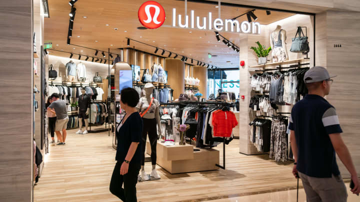 Pedestrians seen walking past Canadian athletic apparel retailer Lululemon in Shanghai.