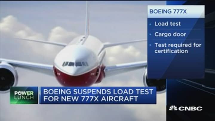 Boeing suspends load test on new 777X aircraft; Tesla driver asleep at wheel?