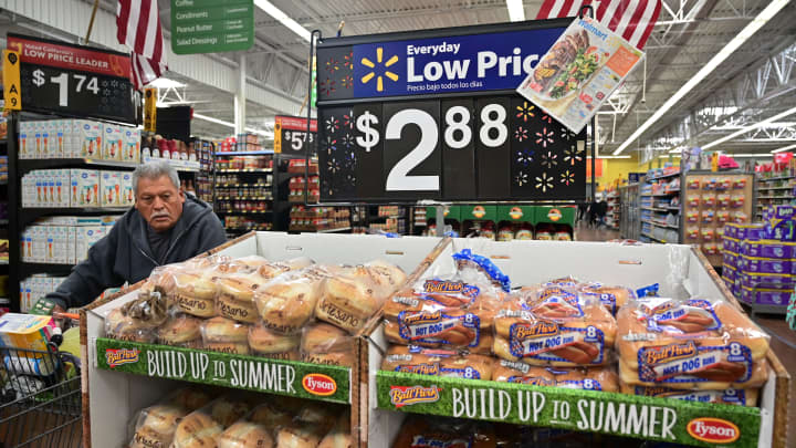 A man pushes his shopping cart past bread for sale at a Walmart Supercenter store in Rosemead, California on May 23, 2019.