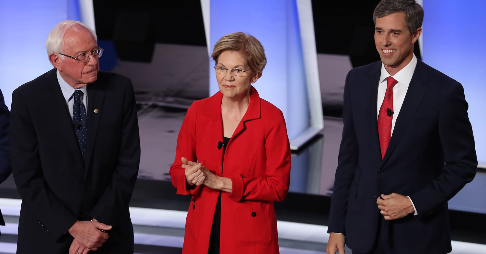 Democratic presidential candidates former Texas congressman Beto O'Rourke (left), Sen. Elizabeth Warren (D-Mass.), and Sen. Bernie Sanders (I-Vt.) take the stage at the Democratic Presidential Debate in Detroit, Michigan.