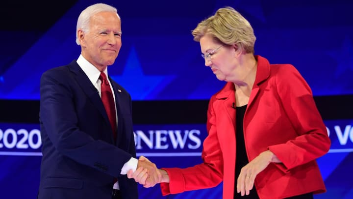 Democratic presidential hopefuls Massachusetts Sen. Elizabeth Warren and former Vice President Joe Biden shake hands as they arrive onstage for the third Democratic primary debate of the 2020 presidential campaign season.
