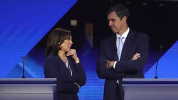 Democratic presidential candidates Sen. Kamala Harris (D-CA) and former Texas congressman Beto O'Rourke converse during a break in the Democratic Presidential Debate at Texas Southern University's Health and PE Center on September 12, 2019 in Houston, Texas.