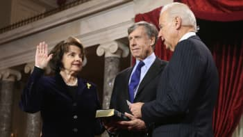 Sen. Dianne Feinstein (D-CA) (L) participates in a reenacted swearing-in with her husband Richard C. Blum and U.S. Vice President Joe Biden in the Old Senate Chamber at the U.S. Capitol January 3, 2013 in Washington, DC.
