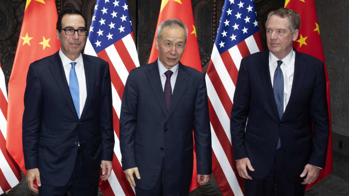 China says US must cancel new tariffs for ultimate trade deal