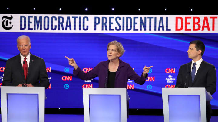 (L-R) Former Vice President Joe Biden, Sen. Elizabeth Warren (D-MA) and South Bend, Indiana Mayor Pete Buttigieg react on stage during the Democratic Presidential Debate at Otterbein University on October 15, 2019 in Westerville, Ohio.