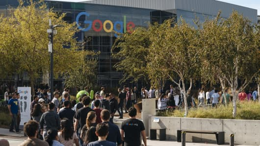 Google employees at the tech giant's headquarters in Mountain View, California, walk off the job to protest the company's handling of sexual misconduct claims.