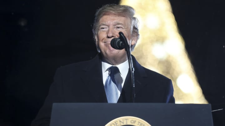 U.S. President Donald Trump smiles during the 97th Annual National Christmas Tree Lighting ceremony in Washington, D.C., on Thursday, Dec. 5, 2019.